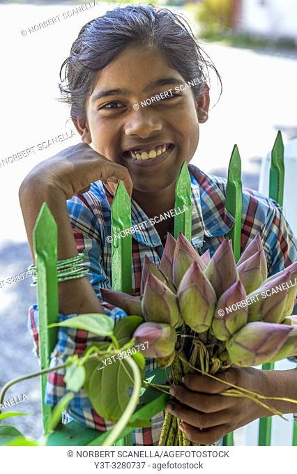 Myanmar (formerly Burma). Kayin State (Karen State). Hpa An. Saleswoman lotus flowers
