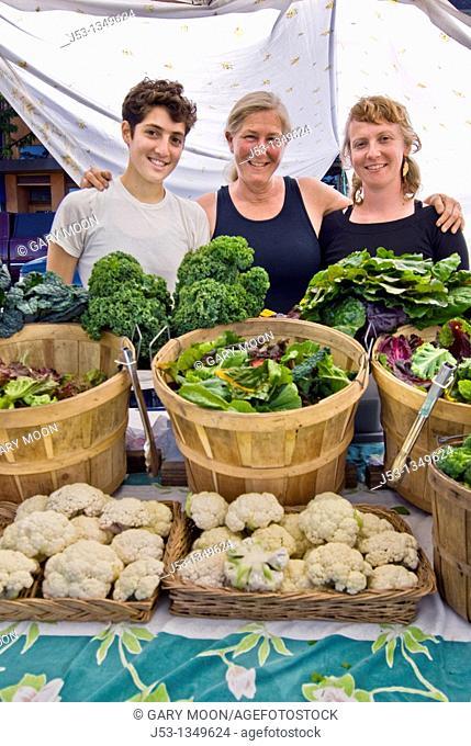 Women selling produce at farmers' market, Arcata, California