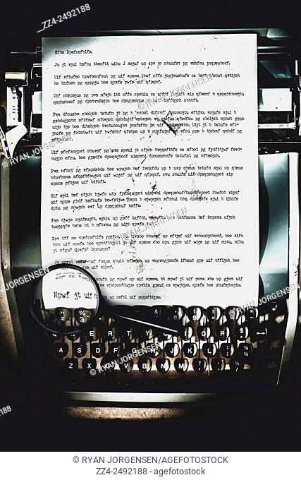 Vintage security equipment analysing and decoding an encrypted transcript made with scrambled code. An encryption to break the oppression