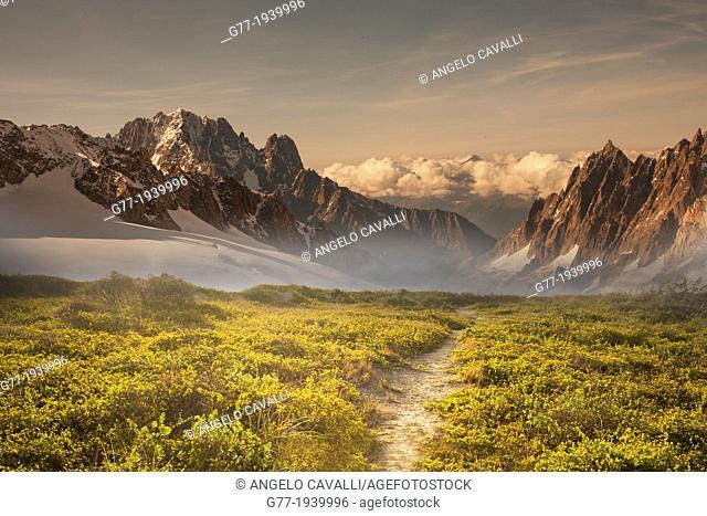 Path to a mountain range at sunset