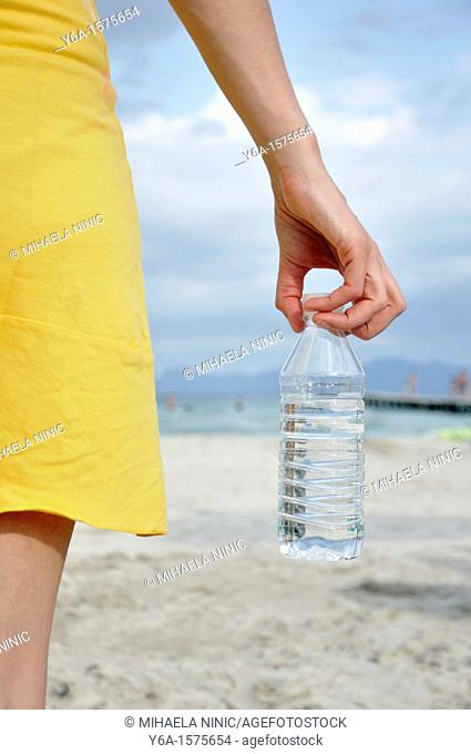 Young woman holding water bottle