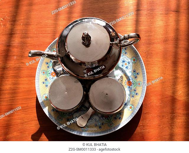 Elegant tea service setting on a round platter, table top, Canada