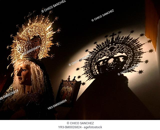 The shadow of the crown of an image of the Virgin Mary is displayed in a church during Semana Santa in the church of Prado del Rey, Sierra de Grazalema
