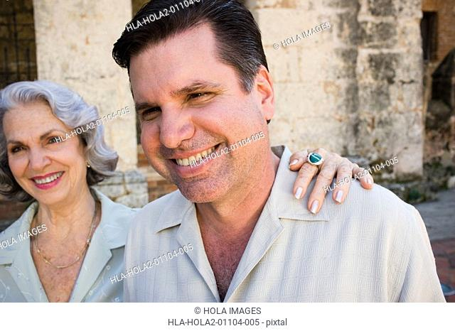 Mature man and his mother smiling