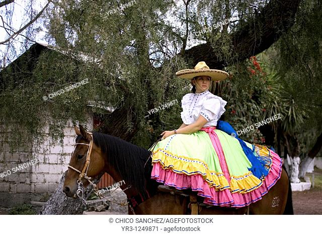 A member of the El Herradero team sits on her horse before competing in an Escaramuza in Mexico City. Escaramuzas are similar to US rodeos