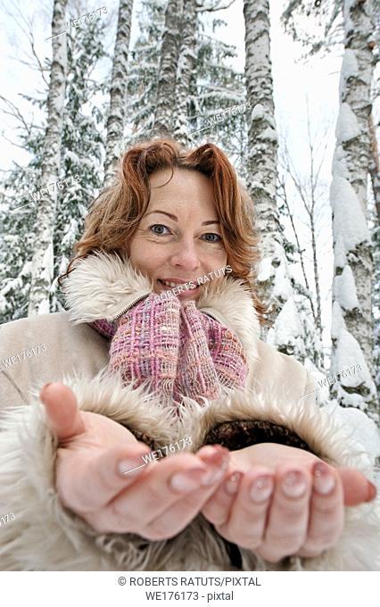 Portrait of red-haired woman in winters day. Latvia