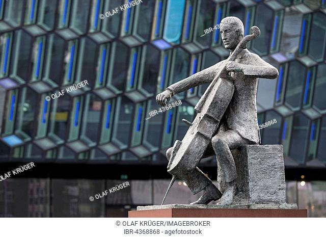 Sculpture, musician, cellist in front of Harpa, Concert Hall and Conference Centre, Reykjavik, Iceland
