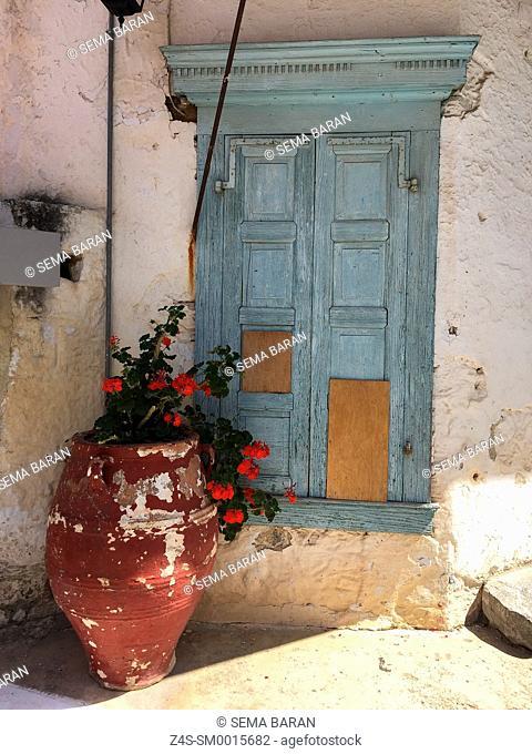 Blue entrance door with flower pot, Lasithi Region, Crete, Greek Islands, Greece, Europe