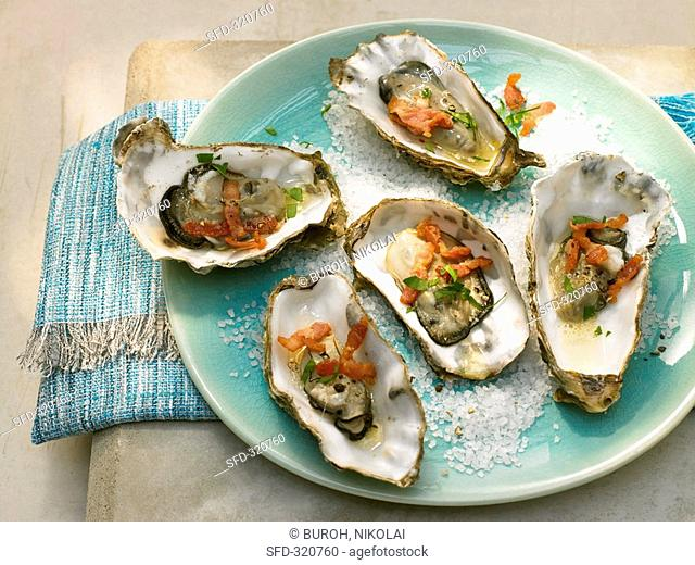 Grilled oysters with bacon