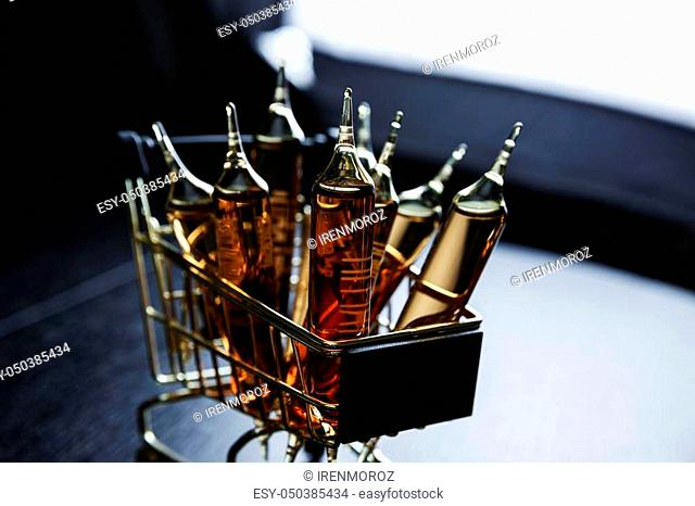 Many brown ampoules set in shopping cart