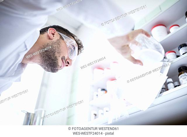 Man working in laboratory of a pharmacy
