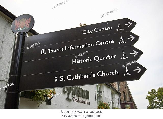 Tourist information sign and walking distances to places in the historic quarter Carlisle Cumbria England UK