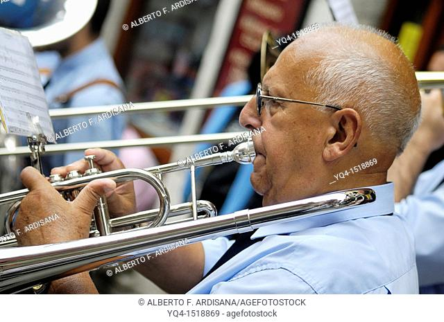 Musician playing the trumpet during the festival of San Roque de Llanes, Asturias, Spain