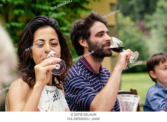Couple enjoying red wine at family meal