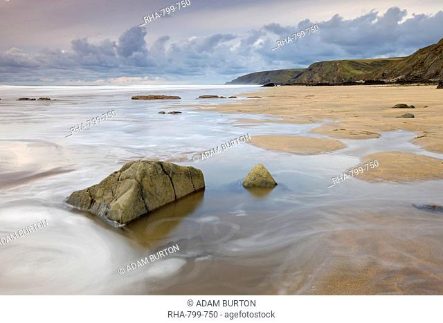 Incoming tide on Sandymouth Beach, Cornwall, England. United Kingdom, Europe