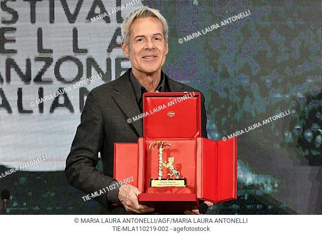Claudio Baglioni poses with the 'Amico di Sanremo ' Award (Friends of Sanremo) during the final press conference of 69th Sanremo Music Festival, Sanremo