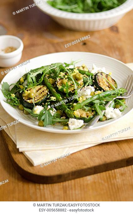 Asparagus and courgette salad with feta and sesame seeds