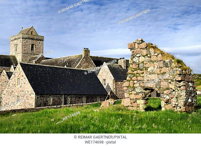 Medieval pink granite stone ruins of the Bishop's House next to the museum at Iona Abbey monastery on Isle of Iona Inner Hebrides Scotland UK