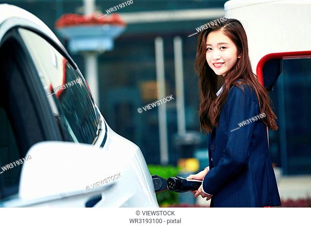 Young women to recharge electric cars