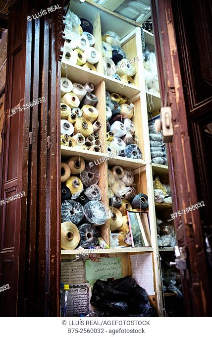 Store shelves filled with spools of thread in Fez Medina. Fes, Historic City, Heritage, Morocco, Africa