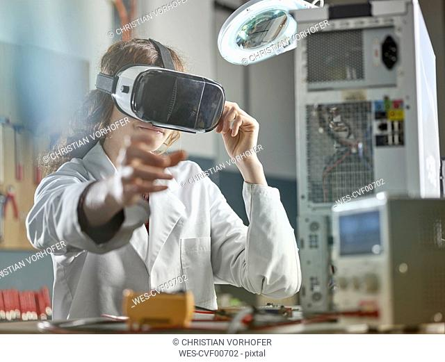 female engineer using virtual reality headset