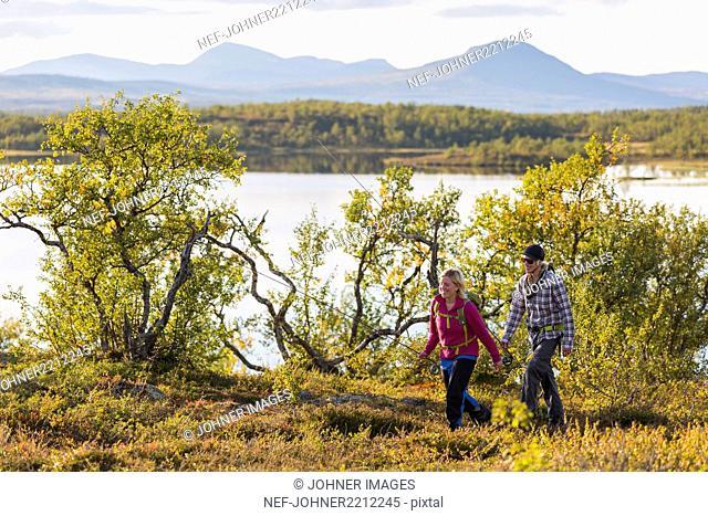 Couple walking at lake