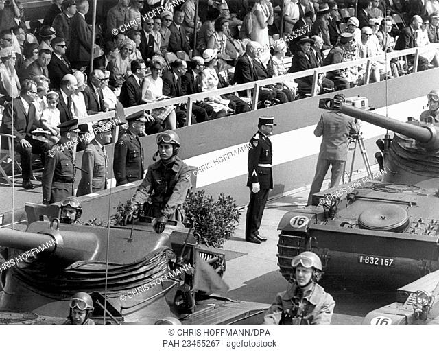 French tanks driving past a VIP stand during a parade on occasion of the 'Armed Forces Day' on 14th May 1966 in Berlin. To be seen are the three town majors of...
