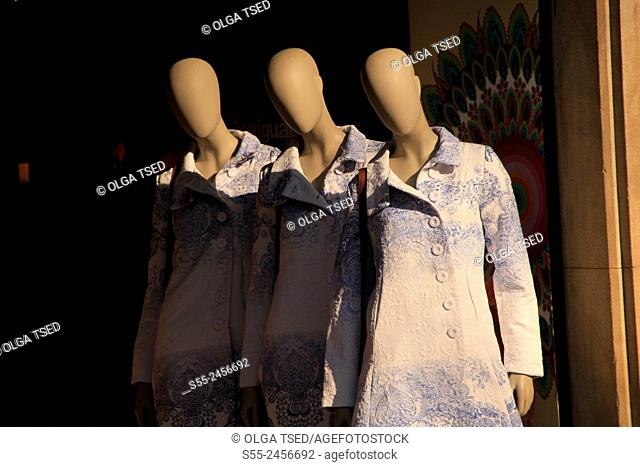 Three mannequins weared in Desigual coats, Barcelona, Catalonia, Spain