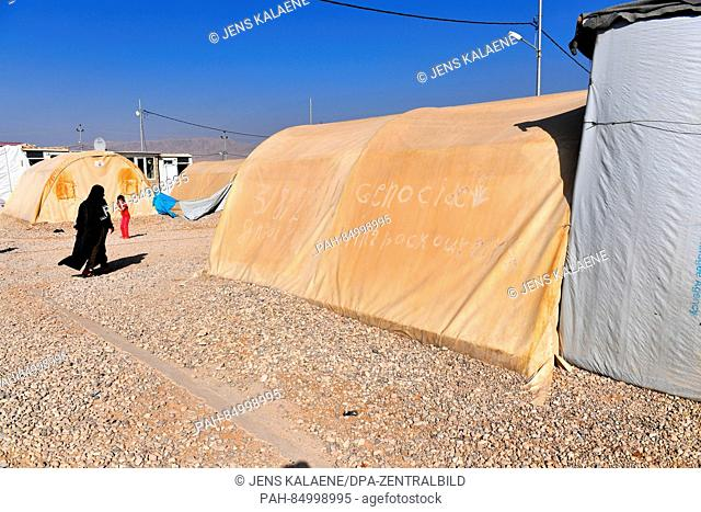 """""""""""""""""""""""Genocide - bring back our girls"""""""" was etched unto the dust settling on the tent walls at the refugee camp Mamilian in the region Dohuk, Iraq"""