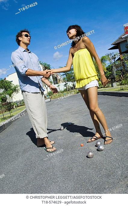 couple shaking hands after playing bocci
