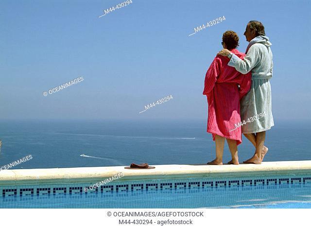Couple in the swimming-pool. Javea. Alicante. Spain
