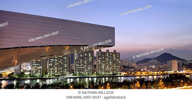 Busan Cinema Centre, Coop Himmelblau, Busan, South Korea, 2011, detailed of main cantilever canopy roof nose with city lights at dusk, COOP HIMMELBLAU