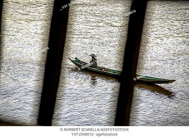 Asia. South-East Asia. Laos. Province of Luang Prabang, city of Luang Prabang, World heritage of UNESCO since 1995. Fisherman on Mekong river