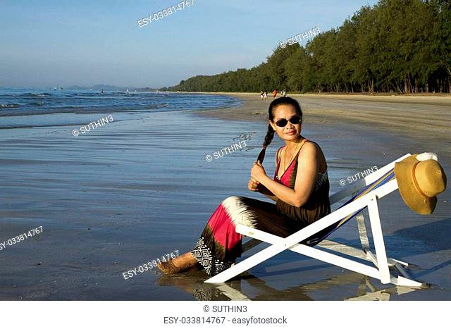 Lady relax with sunshine on beach Nava Gorn at sea of country, Thailand