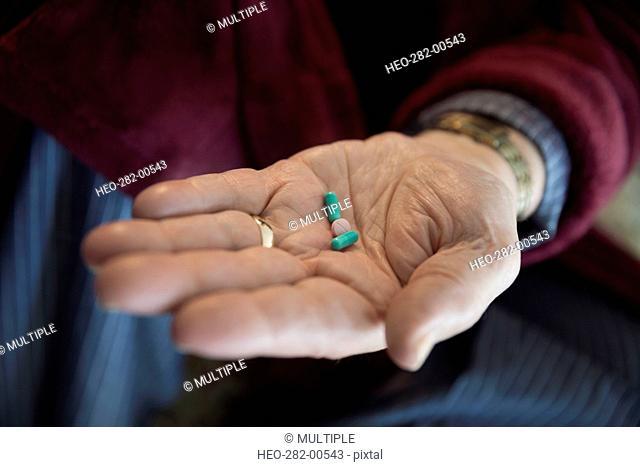 Close up senior man holding prescription medication