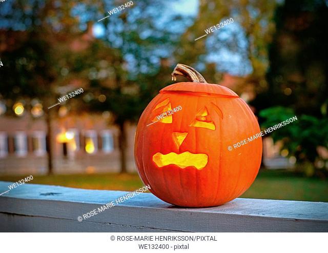 Jack O'Lantern. Carved pumpkin lit with a candle inside on Halloween night in Winston Salem, North Carolina