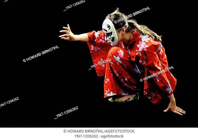 Mime artist in kimono and mask