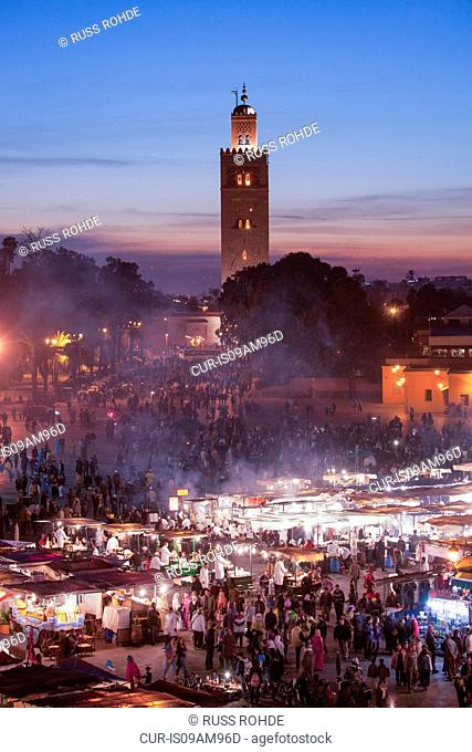 Crowded market at sunset, Djemaa el-Fnaa Square, Marakech, Morocco