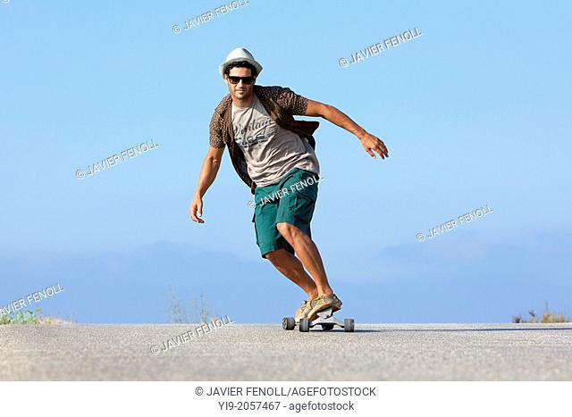 boy skating with hat and sunglasses