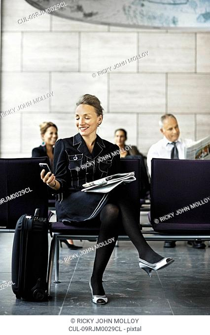 Business woman with a suitcase, waiting