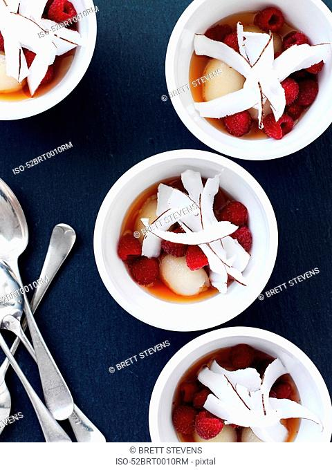 Cups of fruit salad with coconut