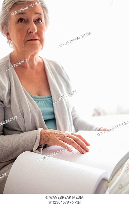 senior woman is reading