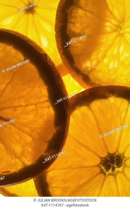 Thin slices of orange lit from behind