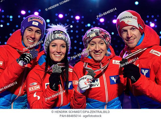 Austrian athletes (L-R) Stefan Kraft, Jacqueline Seifriedsberger, Daniela Iraschko-Stolz and Michael Hayböck celebrate taking silver at the Nordic World Ski...