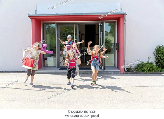Happy pupils leaving school