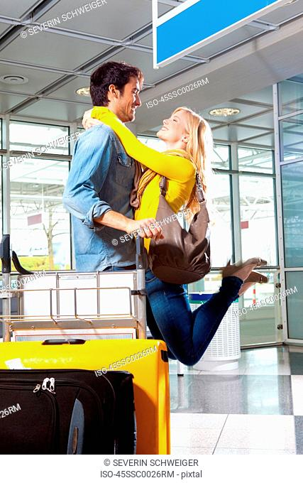 Couple playing in airport