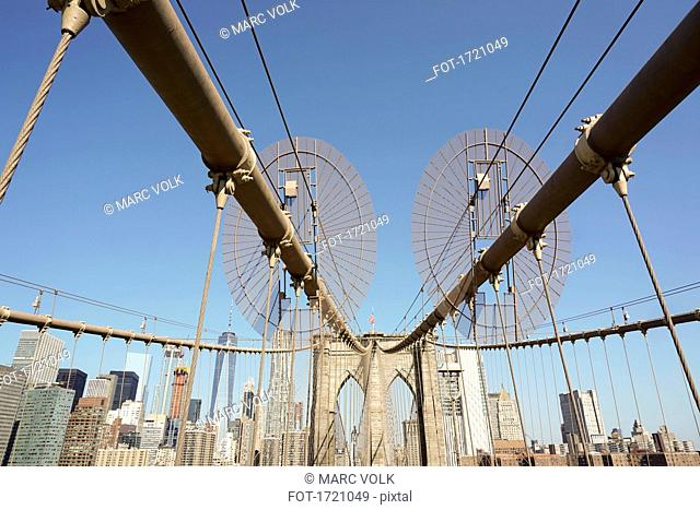 Low angle view of Brooklyn Bridge against clear sky, New York City, New York, USA