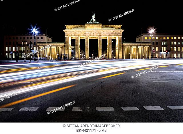 Brandenburg Gate with light trails at night, Berlin, Germany