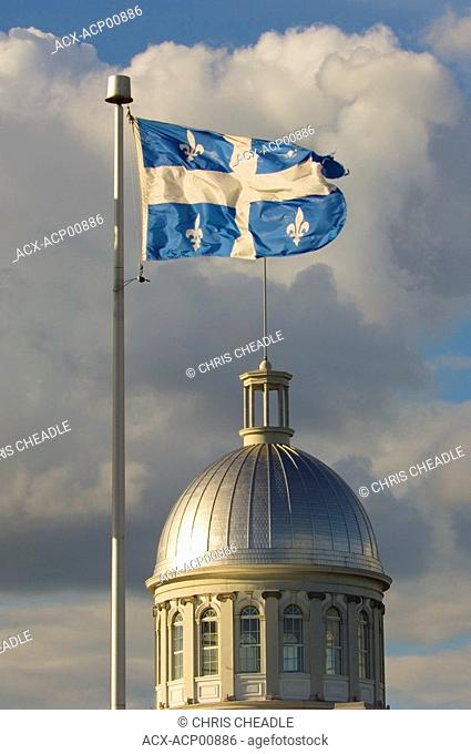 Flag of province of Quebec flies over the dome of Bonssecour Market in old Montreal, Montreal, Quebec, Canada