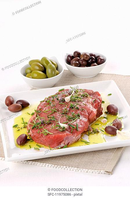 Raw, marinated beef steak